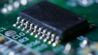 Macro Close Up Of Electronic Chip With Circuits Rotating Around 5