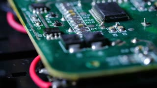 Macro Close Up Of Electronic Chip With Circuits Rotating Around