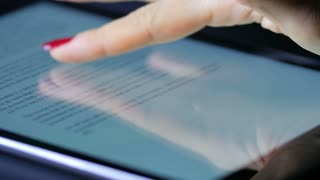 Macro Close Up Of Female Hand Swiping Text On An Ipad Tablet Device 4
