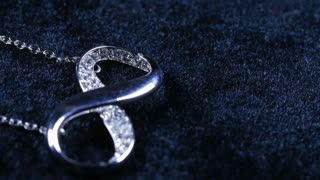 Macro Close Up Of Infiniti Necklace Jewelry Rotating Around