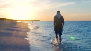 Male Model Walking Along Caribbean Beach At Sun Set 2