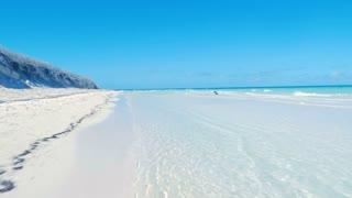 Moving Along Beautiful Caribbean Beach With Blue Sky