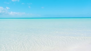 Moving Into Beautiful Caribbean Shallow Ocean Water On A Sunny Afternoon