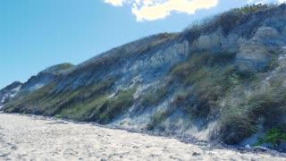 Panning Across Caribbean Sand Dune Along Tropical Ocean
