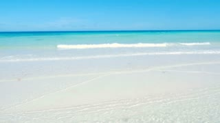 Panning To Reveal Beautiful Caribbean Beach With Blue Sky
