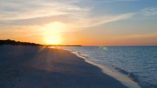 Showing A Beautiful Caribbean Sun Set On A Tropical Beach 3