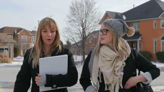Two Young Females Walking And Talking To Each Other In A Nice Neighbourhood In Winter 1