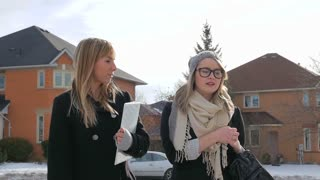 Two Young Females Walking And Talking To Each Other In A Nice Neighbourhood In Winter 2