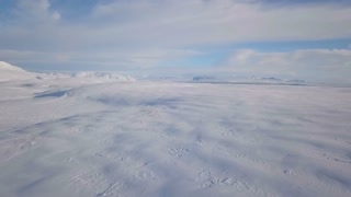 Aerial Drone Above Snow Covered Iceland On Sunny Day 1