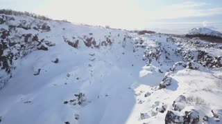 Aerial Drone Flying Above Snow Covered Winter Rock Valley In Iceland 2