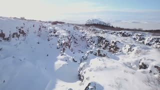 Aerial Drone Flying Above Snow Covered Winter Rock Valley In Iceland 3