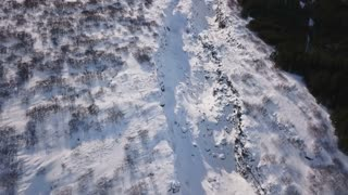 Aerial Drone Flying Above Snow Covered Winter Rock Valley To Reveal Iceland Mountains 1