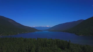 Aerial Drone Footage In The Summer High In The Sky Showing Snowy Mountains In The Background 2