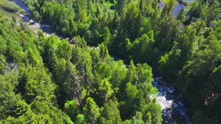 Aerial Drone Revealing Beautiful Water Rapids Going Into Lake With Mountains 3