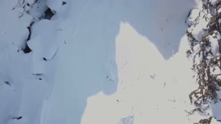 Aerial Drone Rising Above Snow Covered Winter Rock Valley In Iceland 1
