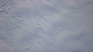 Aerial Drone Slowly Turning Down Showing Snow Covered Iceland 2