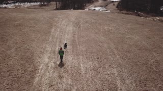 Aerial Of Person Throwing A Stick For His Pet Border Collie Dog 2