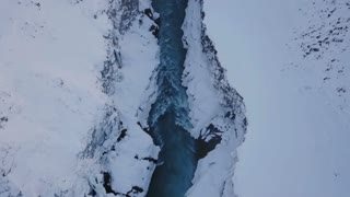 Aerial View Above Valley With Rushing Water During Winter In Iceland 1