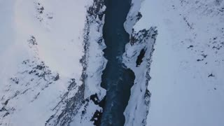 Aerial View Above Valley With Rushing Water During Winter In Iceland 2