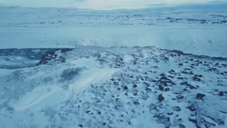 Aerial View Flying Over Mountain Cliff To Reveal Rushing Water Below Winter Iceland 1