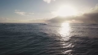 Aerial View Flying Over Ocean Water Towards Sunset 1