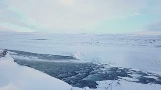 Aerial View Flying Over Rushing Water In Winter Iceland