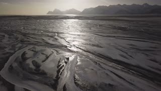 Beautiful And Sunny Iceland Aerial View Of Frozen Ground With Mountains 1