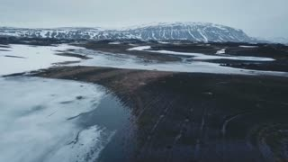 Iceland Aerial View Flying Fast Above Moss Covered Field In Winter 1