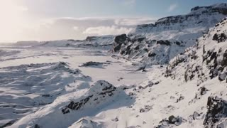 Iceland Aerial View Of Frozen Lake At The Bottom Of A Glacier With Mountains In Winter 1