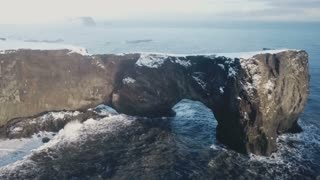 Iceland Aerial View Of Large Mountain Arch With Ocean Below 1