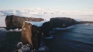 Iceland Aerial View Of Large Mountain Arch With Ocean Below 4