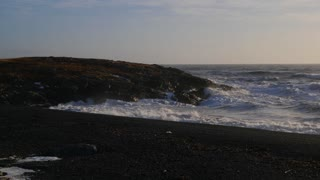 Iceland Beautiful Black Sand Beach Ocean Shoreline On Sunny Day 1