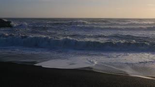 Iceland Black Sand Beach Shoreline With Crashing Ocean Waves On Sunny Day 2