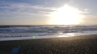 Iceland Black Sand Beach Shoreline With Crashing Ocean Waves On Sunny Day 4