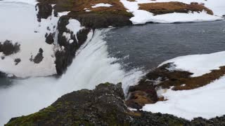 Iceland Fast Rushing Water Over Waterfall In Winter 1