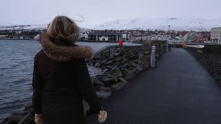 Iceland Female Tourist Walking And Exploring Along Ocean In Akureyri 1