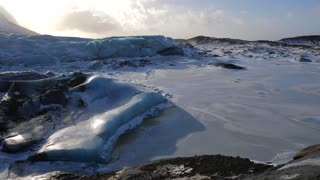 Iceland Giant Blue Glacier Ice Chunks With The Sun Peaking 1
