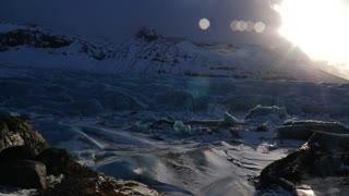 Iceland Giant Blue Glacier Ice Chunks With The Sun Peaking 2