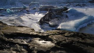 Iceland Giant Blue Glacier Ice Chunks With The Sun Peaking 4