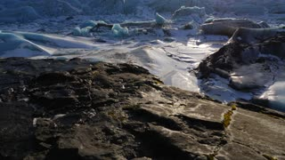 Iceland Giant Blue Glacier Ice Chunks With The Sun Peaking 5