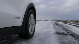 Iceland Low View Of 4 X 4 Vehicle Driving On Ice Covered Off Road In Winter 1