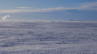 Iceland Panning Across Large Snow Covered Land On A Sunny Day 2