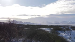 Iceland Panning Across Snow Covered Land With Valley With Mountains 1