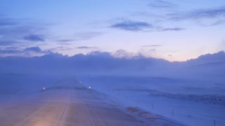 Iceland View Of Strong Winds Blowing Snow Over Highway 1