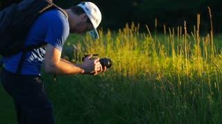 Man Taking Handheld Video In Summer Field 04