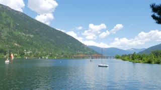 Pan Across Beautiful Kootenay Lake In Nelson In The Summer With Sail Boats 01