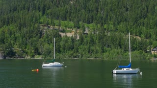Pan Across Beautiful Kootenay Lake In Nelson In The Summer With Sail Boats 02