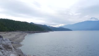 Pan Of Beautiful British Columbia Lake With Mountains And Clouds 01