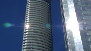 Panning Across Tall Condo Building On Sunny Day 1