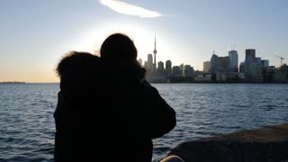 Photographer Sitting Down Taking Photos With Dslr Of Toronto Cityscape 1